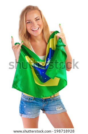 Happy football fan, beautiful blond girl holding in hands Brazilian national flag isolated on white background. - stock photo