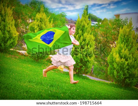 Happy football fan, cute little girl running on backyard with national Brazil flag, sportive childhood, football championship concept - stock photo