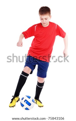 Happy football player playing football