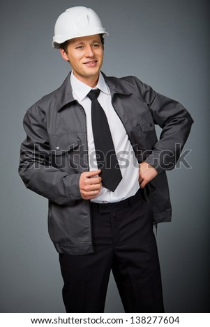 Happy foreman looks at the work done - stock photo