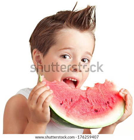 Happy four years old boy smiling with watermelon, isolated on white