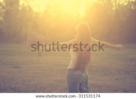 Happy free woman - stock photo