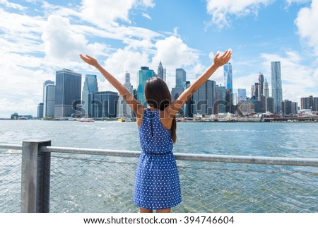 Happy free woman cheering at NYC New York city urban skyline with arms up raised in the sky. Success in business career, goal achievement or carefree freedom successful urban person concept. - stock photo