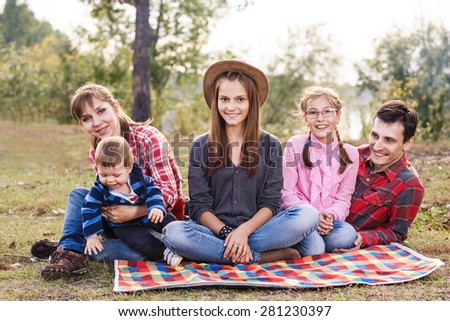 Happy frendly family have a picnic outdoor