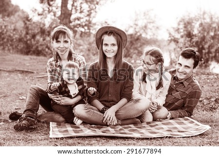 Happy frendly family have a picnic outdoor - stock photo