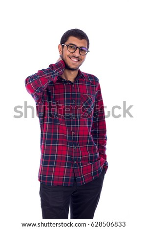 Happy friendly young man with hand in pocket and the other on the  neck, guy wearing red caro shirt and jeans with glasses, isolated on white background