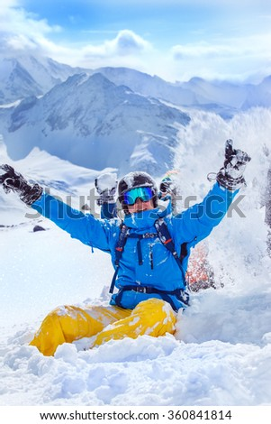 Happy friends at ski resort playing with snow  - stock photo