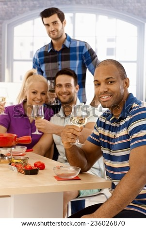 Happy friends celebrating together, drinking, having fun. - stock photo