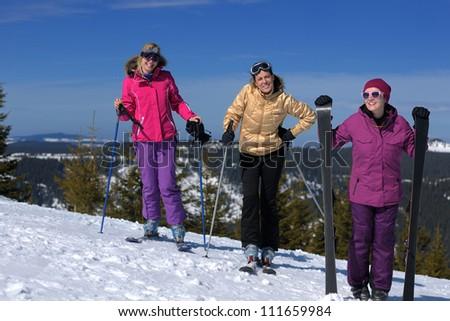 happy friends group of woman girls have fun at winter season at beautiful sunny  snow day with blue sky in background