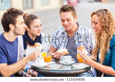 Happy Friends having a Traditional Italian Breakfast - stock photo