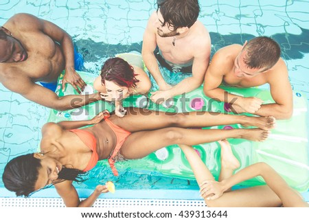 Happy friends having fun in the swimming pool .spending funny afternoon together - stock photo