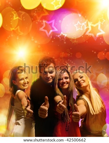 Happy friends in the night club - stock photo