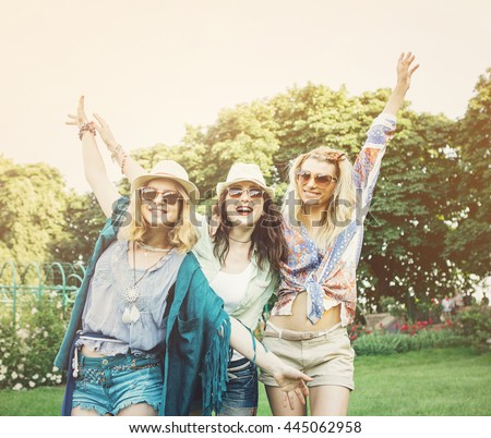 Happy friends in the park on a sunny day . Summer lifestyle portrait of three hipster women  enjoy nice day, wearing bright sunglasses. Best friends girls having fun, joy. Lifestyle - stock photo