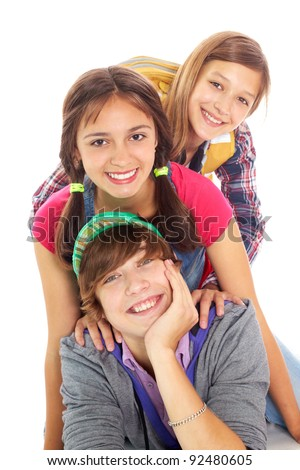Happy friends looking at camera in isolation - stock photo