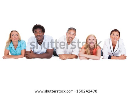 Happy Friends Lying In A Row Isolated On White Background - stock photo