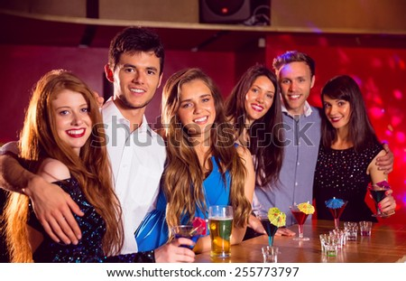 Happy friends on a night out together at the nightclub