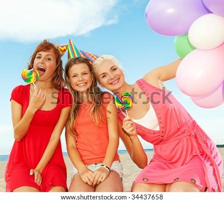Happy friends on the beach - stock photo