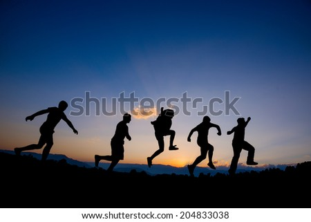 Happy Friends Running On - stock photo