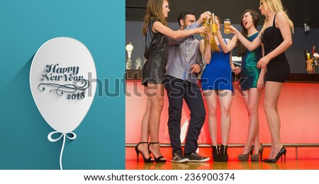 Happy friends standing at a bar against classy new year greeting - stock photo