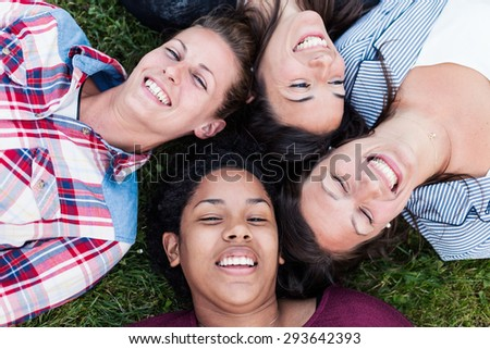 Happy friends taking selfie and laughing. Shallow depth of field