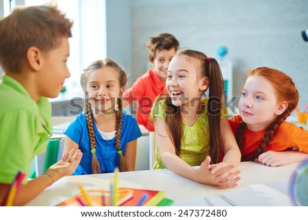 Happy friends talking during break in school - stock photo