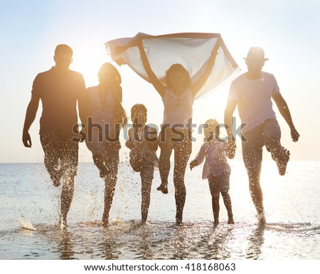 Happy friends with kids ��elebration beach party summer. Holiday and vacation concept