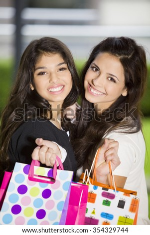 Happy friends with shopping bags - stock photo