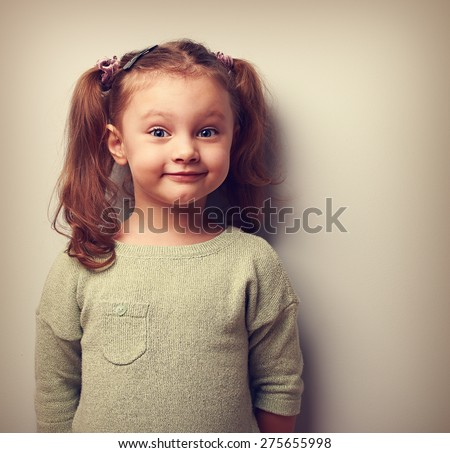 Happy fun girl looking with smile. Happiness in childhood. Vintage closeup portrait - stock photo