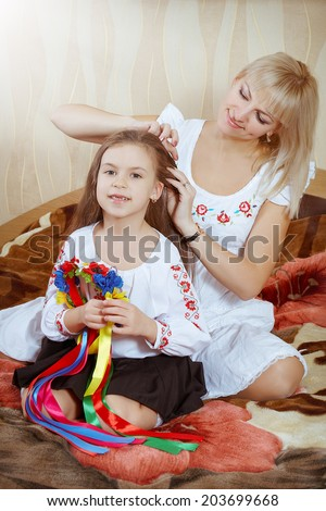 happy funny beautiful mother and little  charming daughter - stock photo