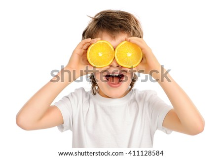 Happy funny boy with fresh oranges. Copy space. Isolated over white. - stock photo
