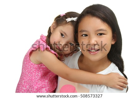 Happy funny girl sisters hugging  isolated on a white background