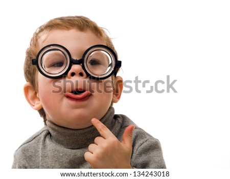 Happy funny kid with glasses show his tongue - stock photo