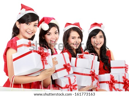 Happy funny people with christmas santa hat holding gift boxes on white background