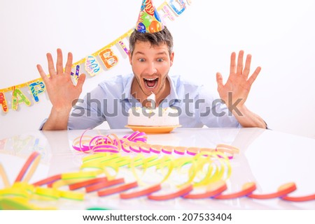 happy funny portrait of man with candles - stock photo