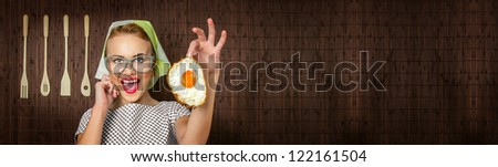 Happy funny woman cook with fried egg - web banner crop concept - stock photo
