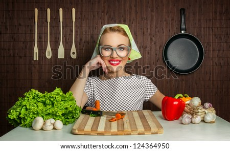 Happy funny woman cook working in the kitchen with vegetables