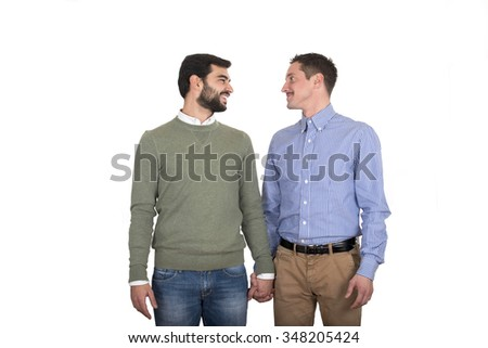 Happy gay couple holding hands - stock photo