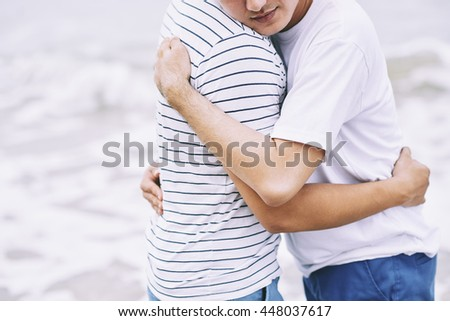 Happy gay couple in love standing outdoors