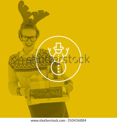 Happy geeky hipster holding presents against snowman - stock photo