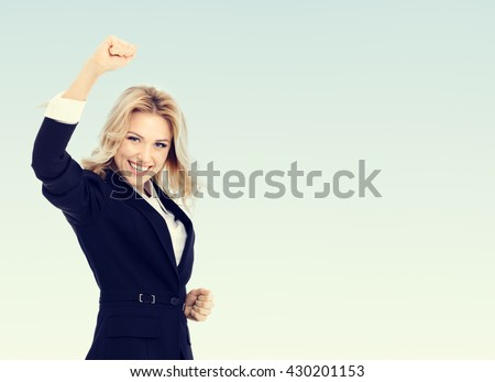 Happy gesturing young cheerful businesswoman, with blank copyspace area for text or slogan