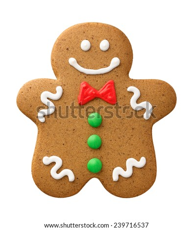Happy Gingerbread Man with green buttons and a red bow tie. The subject is isolated on a white background.
