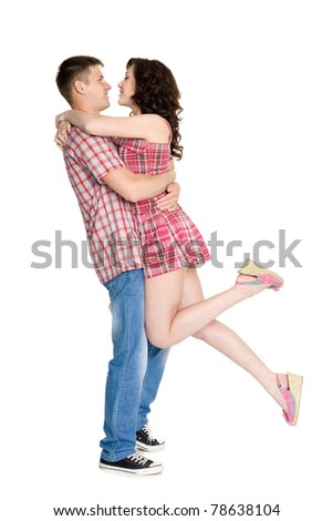 Happy girl and boy in the arms of each other. - stock photo