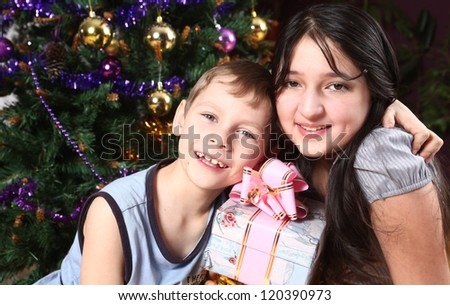 happy girl and the boy with a New Year tree