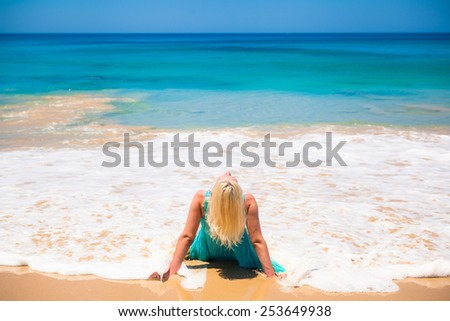 Happy girl   by the sea beach background ocean - stock photo