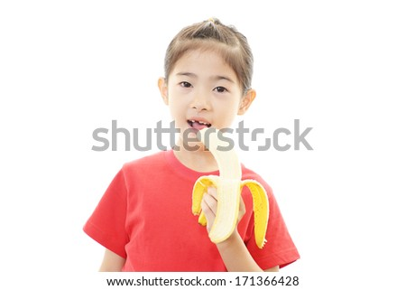 Happy girl eating fruit  - stock photo