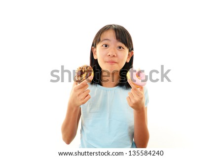 Happy girl eating sweets - stock photo