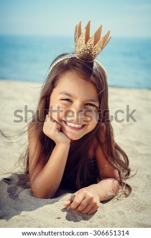 Happy girl enjoying sunny day at the beach.  - stock photo