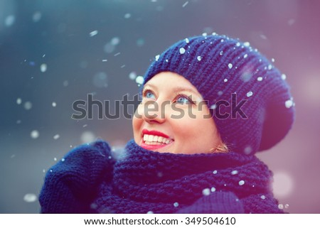 happy girl enjoying winter snow outdoors