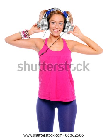 Happy girl enjoys listening music in headphones on a white background.