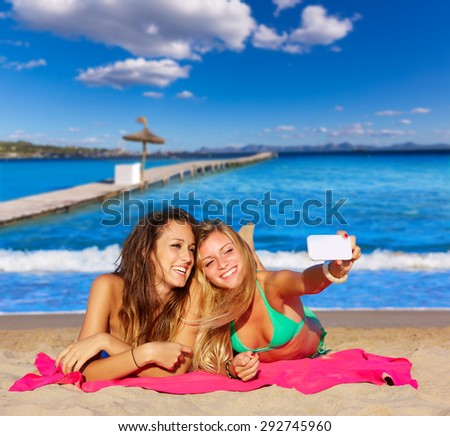 happy girl friends selfie portrait beach sand in Mallorca photo mount - stock photo